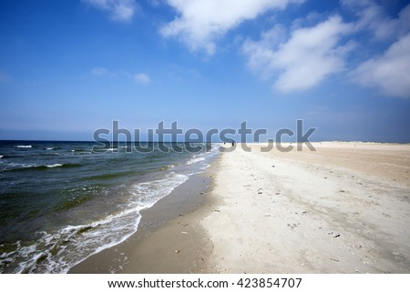 Rømø coastline a sky blue summer day in Denmark. - stock photo
