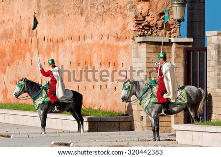 RABAT, MOROCCO - NOVEMBER 25: Royal guard in front of Hassan Tower and Mausoleum of Mohammed V. Mausoleum contains tombs of late King Hassan II and Prince Abdallah. November 25, 2014 in Rabat, Morocco - stock photo