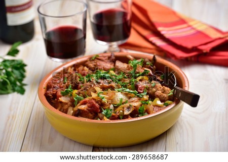 Rabbit stew a basque with onion, pepper, and parsley - stock photo