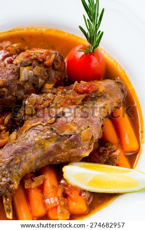 Rabbit stew with vegetables and herbs - stock photo