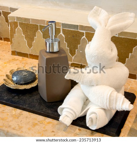 Rabbit Towel with Hand Gel and Soap in the bathroom - stock photo