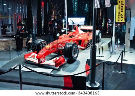 race car formula 1 in amusement park Ferrari World at Yas Island in Abu Dhabi, United Arab Emirates, 2012-11-28 - stock photo