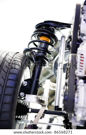 race car shock absorber and wheel. - stock photo