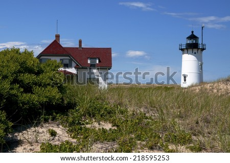 Race Point Lighthouse lies on the edge of the Cape Cod National Seashore, near Provincetown, Massachusetts. - stock photo