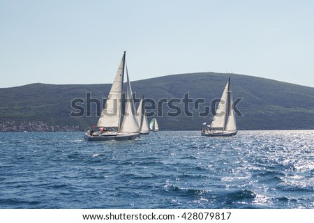 "Race yacht off the coast. Tivat, Montenegro - 26 April, 2016 Regatta ""Russian stream"" in God-Katorskaya bay of the Adriatic Sea off the coast of Montenegro. - stock photo"
