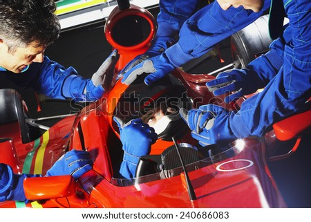 Racecar Driver at the Pit Stop - stock photo