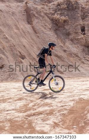 racer bike desert area summer day - stock photo