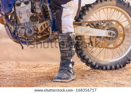 racer on a motorcycle in the desert in summer - stock photo