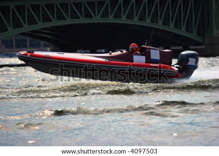 Racing boat on a bend - stock photo