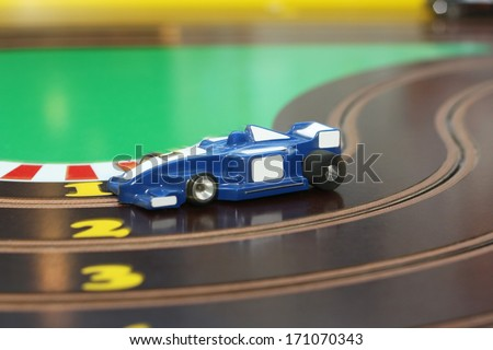 racing car on the toy race track - stock photo