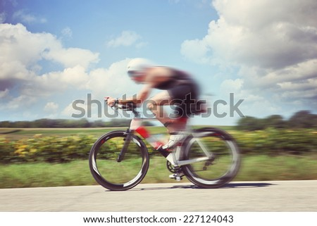 Racing Cyclist. Motion blur - stock photo