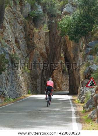 racing cyclist on the way through a tunnel - stock photo