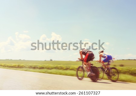 Racing Cyclists. Motion blur. Instagram effect. - stock photo