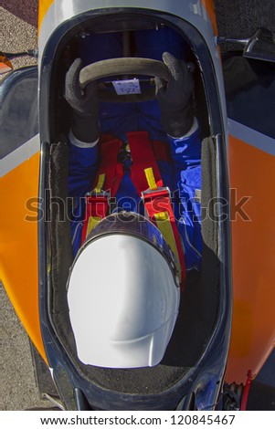 racing pilot waiting in cockpit car - stock photo
