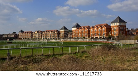 racing track with buildings - stock photo