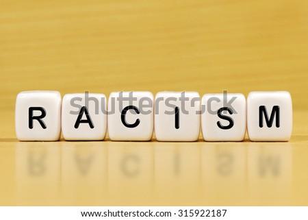 RACISM word on blocks - stock photo