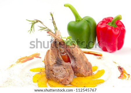 Rack of Lamb with Grilled Peach on white dish - stock photo