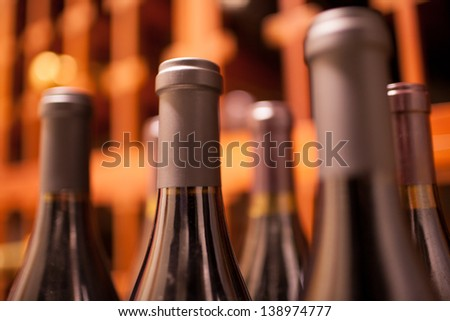 Rack of wine bottles - stock photo