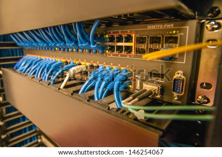 rack with cables and plugs, lan rack - stock photo
