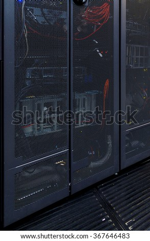 rack with communications equipment and transparent doors - stock photo