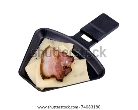Raclette pan with cheese and tasty bacon isolated on white background with clipping path - stock photo