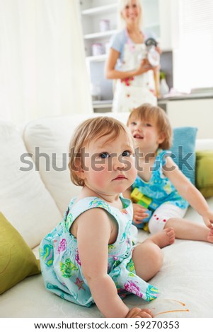 Radiant family playing together in the living-room - stock photo