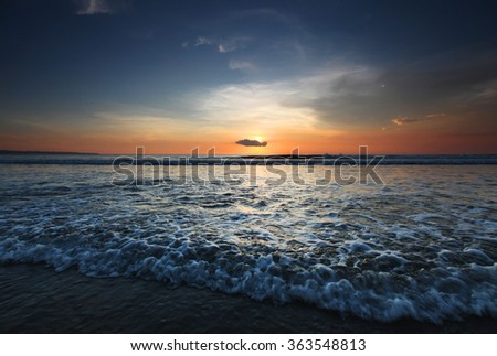 Radiant sea beach sunset on Bali - stock photo