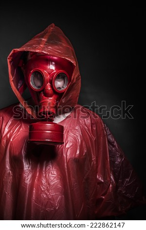 radiation nuclear concept, man with red gas mask - stock photo