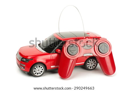 Radio controlled car with control joystick isolated on the white background - stock photo