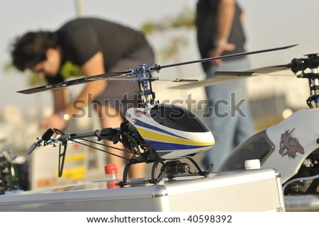 Radio Controlled Helicopter model caring - stock photo