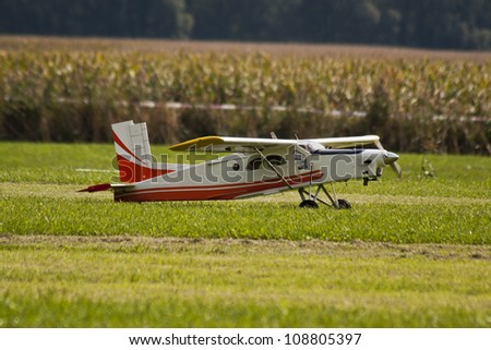 Radio controlled model airplane in a field ready for take-off. - stock photo