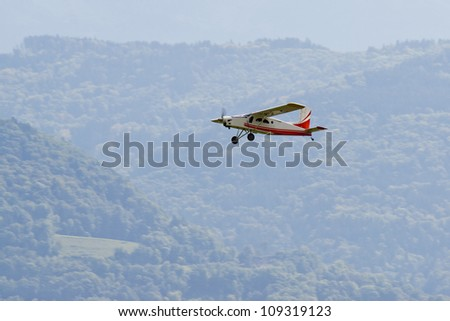 Radio controlled model airplane in flight. - stock photo
