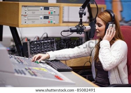 Radio host mixing with a table - stock photo