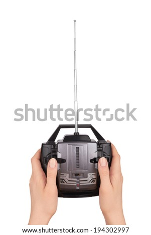 Radio remote control for toy car in hand isolated on white  - stock photo