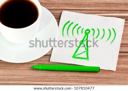 Radio tower on a napkin and cup of coffee - stock photo