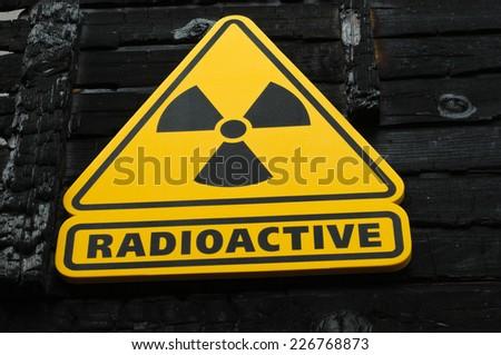 Radioactive Sign on Burned Wooden Background - stock photo