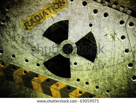 Radioactive symbol on metal plate, industrial grunge background - stock photo