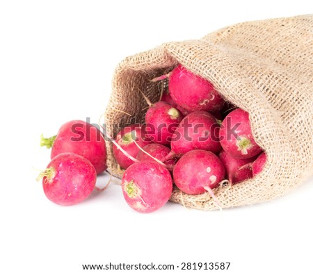 radish in a burlap bag isolated on white background - stock photo