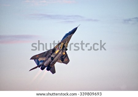 RADOM, POLAND - AUGUST 23, 2015: Display of polish Mig-29 piloted by Cpt. Adrian Rojek. Airshow event on 23 August 2015, Radom, Poland  - stock photo