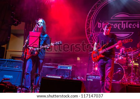 "RADZIONKOW, POLAND - SEPTEMBER 02: The show of Ash'n'beher band during StreetART festival"". September  02, 2012 in Radzionkow,(Silesia province), Poland. - stock photo"
