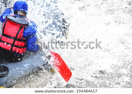 Rafting as extreme and fun sport - stock photo