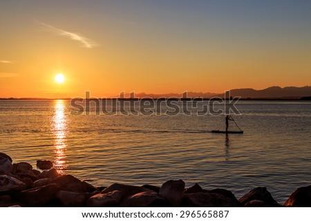 rafting at sunset - stock photo