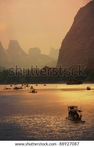 Rafting on Li River, Guilin, in the sunset - stock photo