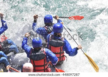 Rafting team splashing the waves, rafting extreme and fun sport - stock photo