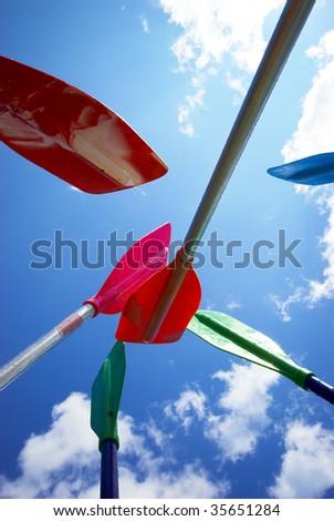 rafting team unity - paddles up - stock photo