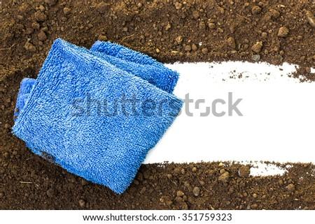 rag wiping a soil on white background - stock photo