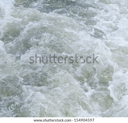 raging foaming water with vials of air - stock photo