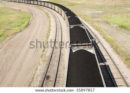 rail cars loaded with coal being transported from nearby mines to power plants in Wyoming - stock photo