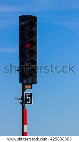 Rail light signal with red light on. - stock photo