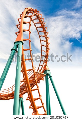 Rail of the roller coaster on blue sky background - stock photo